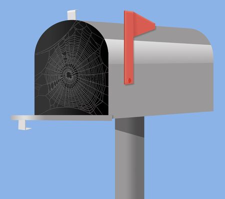 A mailbox has an open door and a spider web or cob web constructed inside from lack of use.  Stockfoto