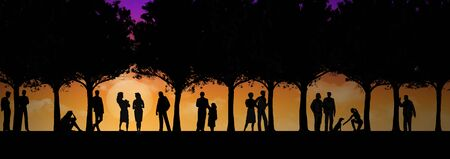 Many people are seen under trees in a park at the end of a day. The figures are silhouettes that contrast with the colorful golden sunset sky behind them.