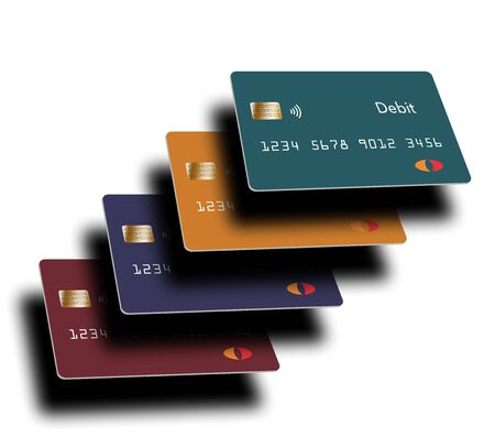 Four debit cards  are seen in the spotlight with deep shadows.