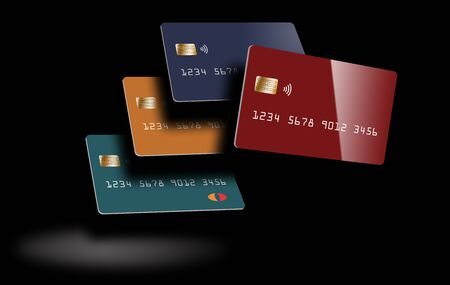 Four debit cards or credit cards are seen in the spotlight with deep shadows.