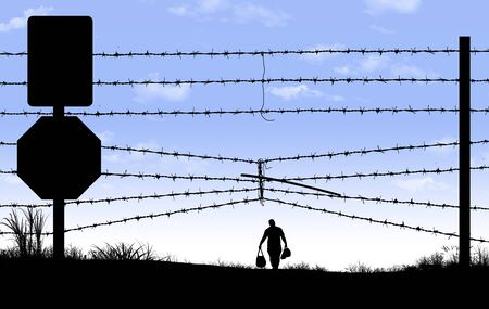 A man is seen in silhouette after breaching a border fence on the southern border of the USA. 版權商用圖片