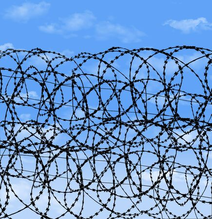 Razor wire, contstantino wire, barbed wire is seen in front of a blue sky in this background image.