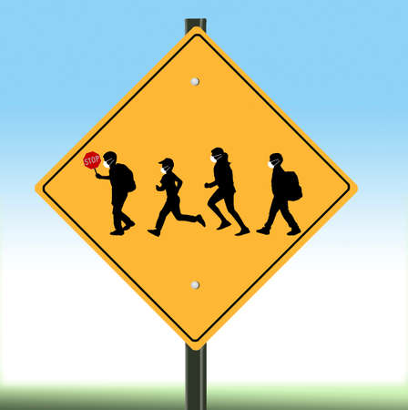A school crossing sign includes silhouettes of children wearing surgical masks in light of the Covid-19 pandemic and it's effects on education.