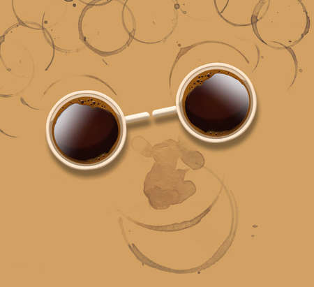 Two cups of coffee look like a pair of sunglasses on a face made of coffee rings from spilled coffee. 版權商用圖片