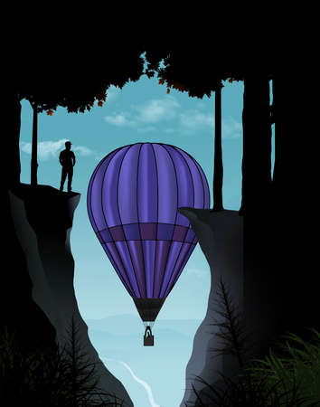 A man stands on a high cliff overlooking a valley as a hot air balloon rises up into his view. 版權商用圖片