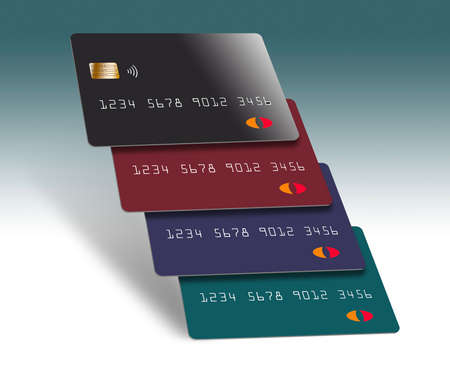 Four credit cards are seen stacked in an interesting formation. 版權商用圖片