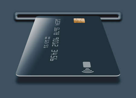 A generic blue credit is seen in a slot of an ATM or a card reader. Фото со стока