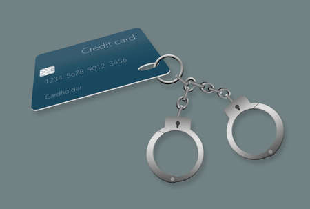 Credit card debt can make someone feel like they are handcuffed to their debt. Here is a pair of handcuffs attached to a credit card.
