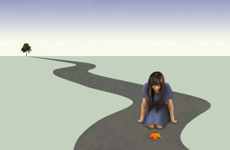 A woman looks at colorful maple leaf on a road that is winding to the horizon on a barren plain with only one green tree standing in the distance. Illustrates idea of inevitable changes coming.