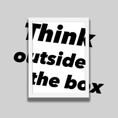"""Type in the words """"Think outside the box"""" extended beyond the edges of a picture frame on a wall."""