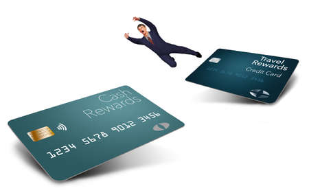A man in a suit makes the big leap from one type of rewards credit card to another in this 3-D illustration. He leaps away from a travel rewards card hoping to reach a new cash back rewards card.