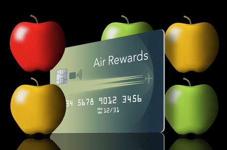Apples are seen with an air rewards credit card. Some air miles rewards can be used during the pandemic to buy groceries and take out food from restaurants.
