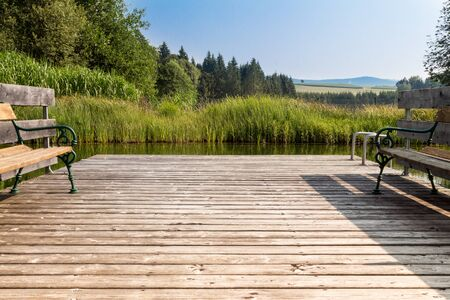 revitalize: Wooden Footbridge on a pond Stock Photo