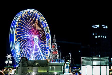 christmas market: Ferris Wheel on Christmas Market Editorial