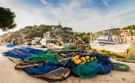 overfishing: Fishing Nets at a harbor Stock Photo