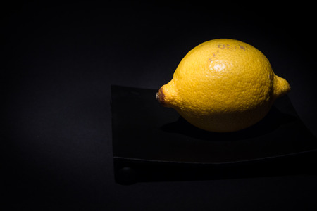 Yellow Lemon in front of black background