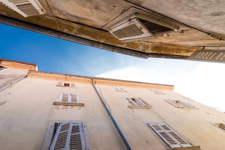 House in croatia with open shutters Standard-Bild