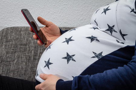 Pregnant woman using a smart phone