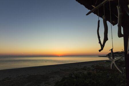 Sunset at the greek coast in Chorefto Stock Photo