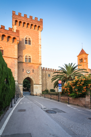 castle with tower and city gate of Bolgheri, the village made famous by a poem by Carducci, in Tuscany, Italy Editorial