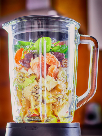Blender with fruits for smoothies Stock Photo