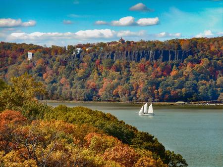 Hudson River Palisades and Sailboat in Autumn