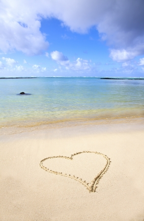 Heart in the sand at the beach of Mauritius. photo