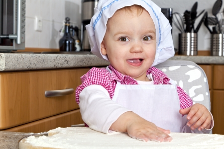 Little girl is baking in the kitchen  photo