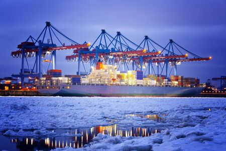 Container Terminal in Hamburg, Germany  Night shot during winter  photo