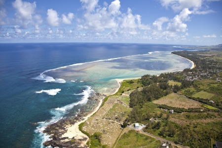 Flying with an helicopter above the paradise island Mauritius.  photo
