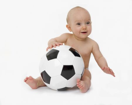 Little baby is playing with a football   photo