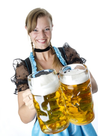Photo shows a woman wearing a Dirndl  She is carring two beer cups   photo