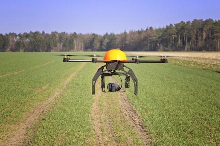 Flying drone in a field