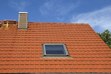 skylights: Red tiled roof