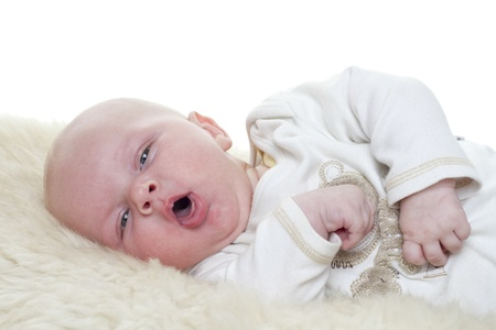 Baby on a sheepskin  Baby is three month old  Studiolight with white background