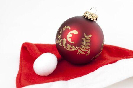 social event: Christmas bauble on a Santa Claus Cap