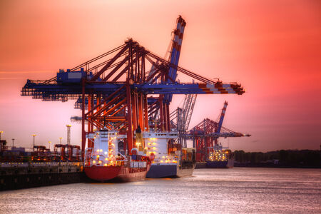 oversized: Container harbor in Hamburg, Germany. Night shoot with red sky.