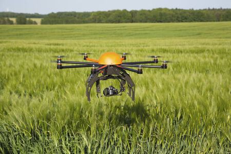 photography themes: Flying drone in field -field in Germany