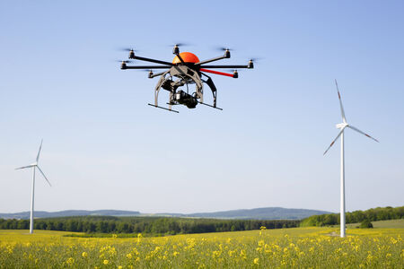 drone: Flying drone in field - field in Germany