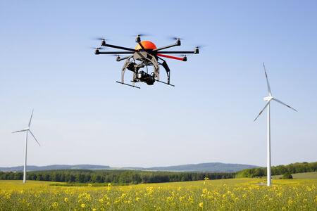 Flying drone in field - field in Germany