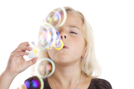 blowing bubbles: Little girl is blowing some bubbles