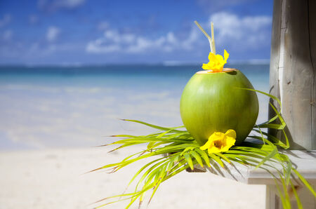 caribbean drink: Coconut at the beach of Mauritius  Stock Photo
