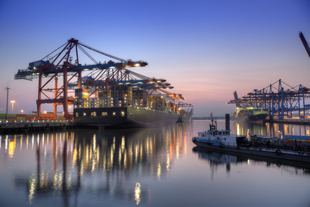 hamburg: Harbour at night in Hamburg, Germany  Container terminal with container cargo ships  Stock Photo