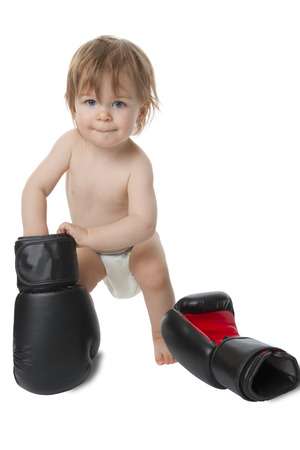 Photo shows a little baby with boxing shoes  Isolated on white  Foto de archivo