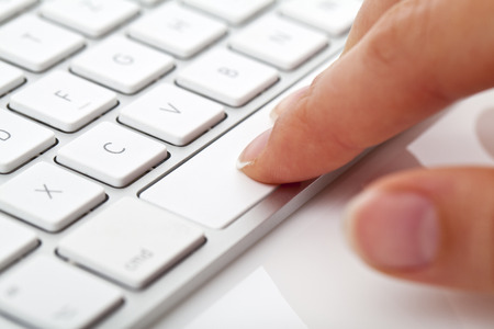 data entry: Hands are working on a computer keyboard.