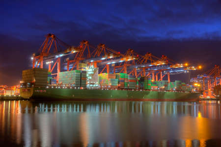 industry moody: Photo of Container Ships in the harbor of Hamburg, Germany.