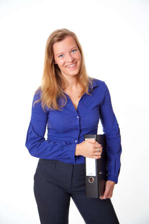 Attractive young woman in a blue shirt. Woman holds a folder. On a gray background