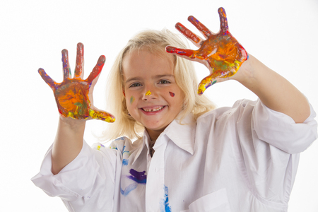 Little girl shows her colored hand to the camera. Studio light with white background.