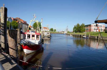 german north sea region: Cutter in a  harbor at Germany. Stock Photo