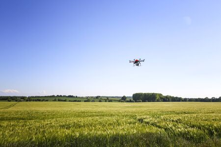 Flying octocopter in the air for video and photo productions Foto de archivo